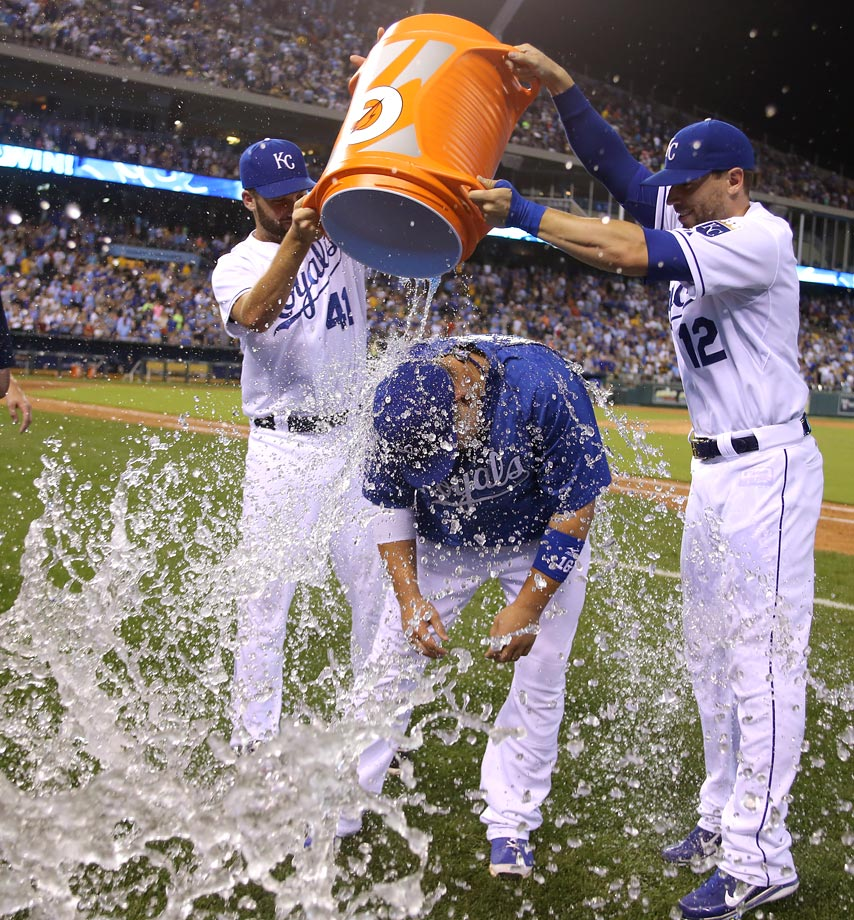 Billy Butler is doused by teammates Danny Duffy and Brett Hayes after the Royals 6-4 win over the Indians.  Butler had a pinch-hit two-run homer with two outs in the eighth inning.