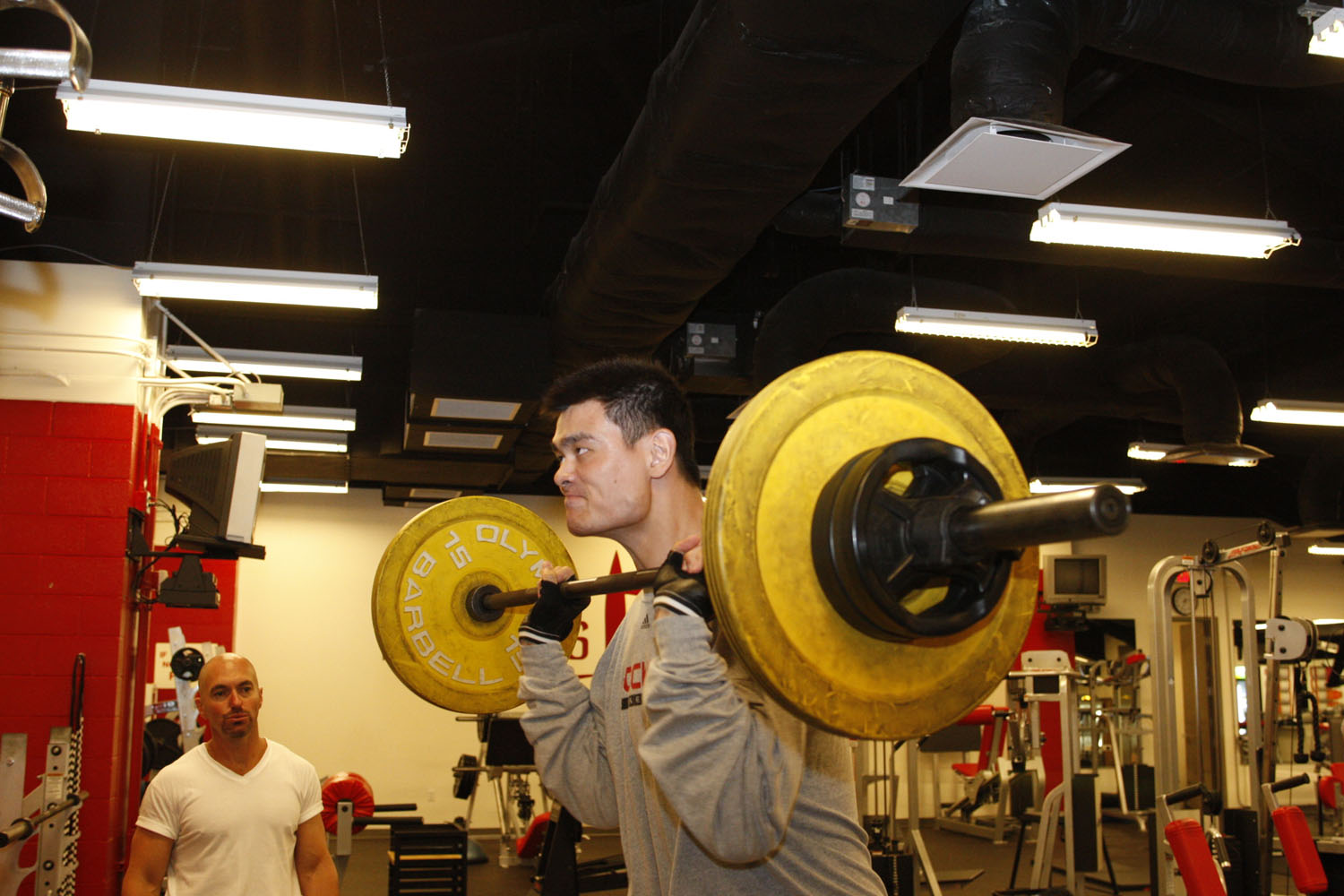 Yao Ming lifting weights during workout in gym at Toyota Center in Houston, Texas in 2007.