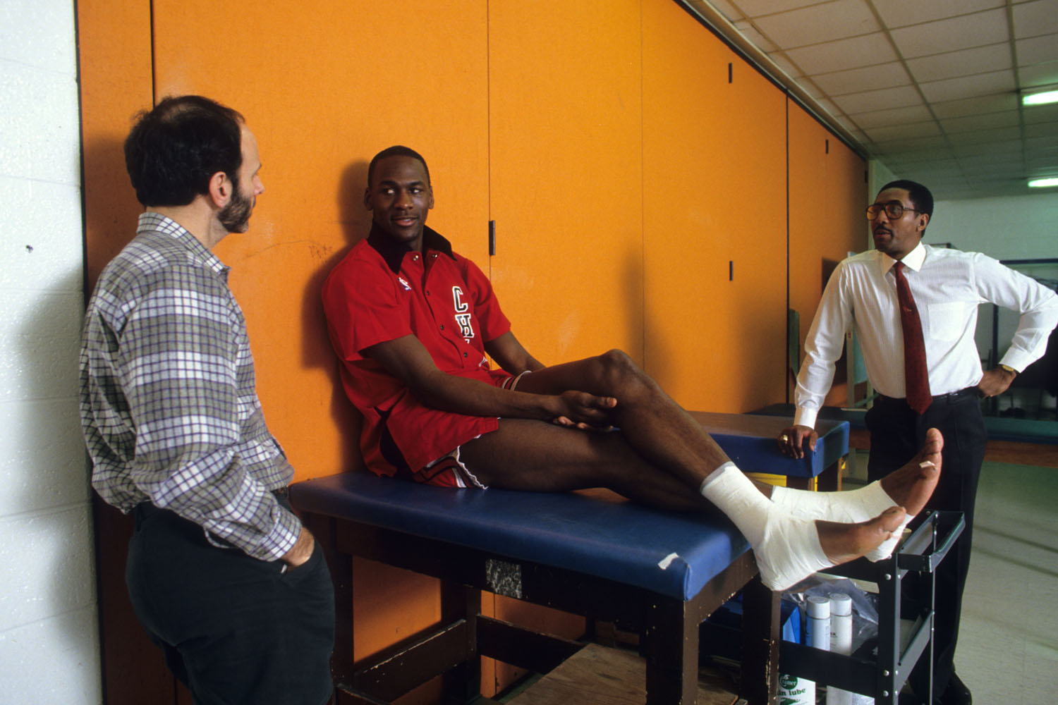 Chicago Bulls guard Michael Jordan on the trainer's table before a game against the Detroit Pistons at the Pontiac Silverdome in 1987.