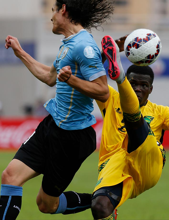 Jamaica's Kemar Lawrence, right, clears a ball beside Uruguay's Edinson Cavani during a Copa America Group B soccer match.