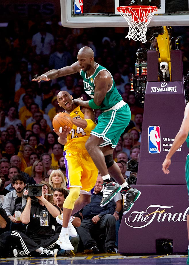 Kevin Garnett bodies a driving Kobe Bryant in a tight Game 7. The Celtics-Lakers rivalry was renewed in a back-and-forth series that saw Los Angeles come out on top for a second straight title.