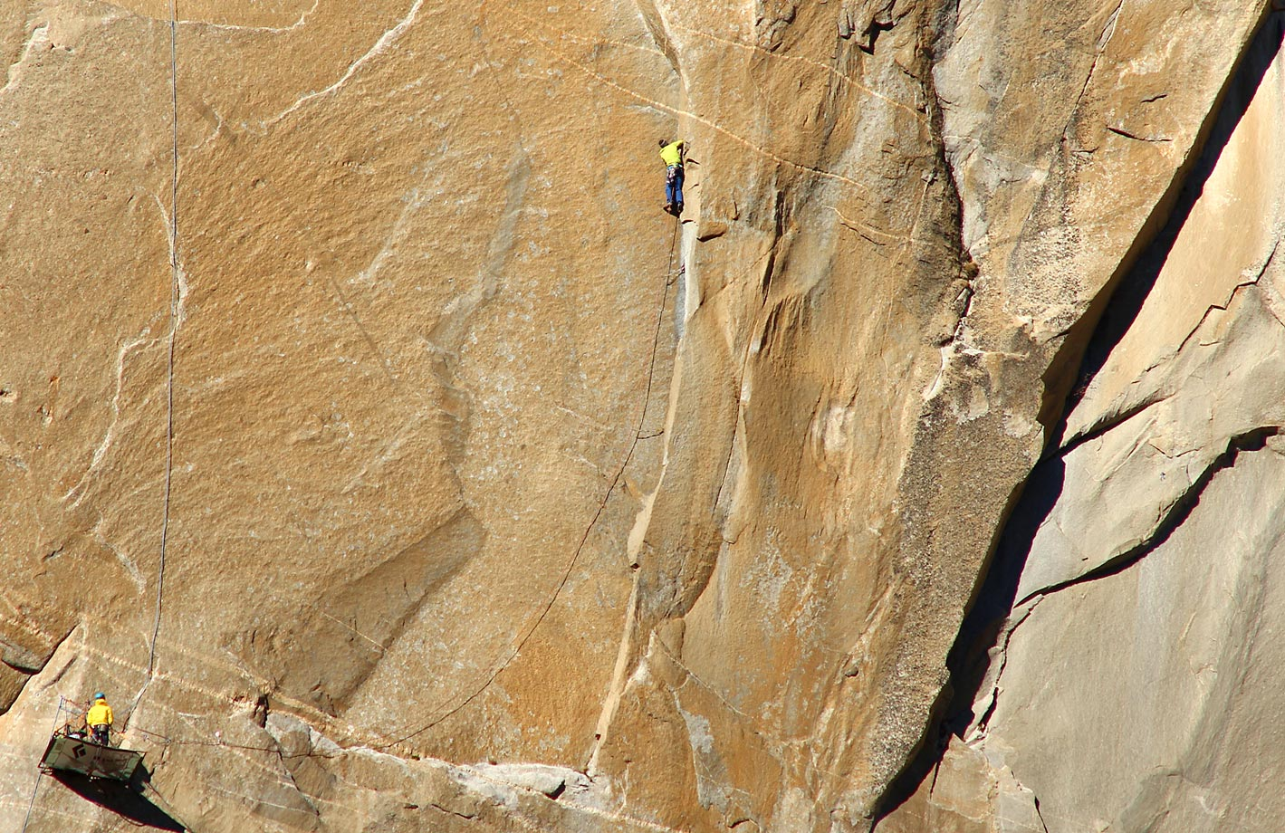 Tommy Caldwell climbing on Pitch 11 – Kevin Belaying in Yellow