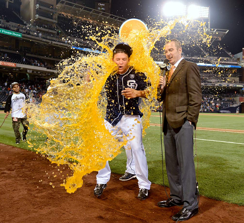 Will Venable and broadcaster Jesse Aglar are doused after Venable hit the game-winning single in the 12th inning of the Padres 3-2 win over the Braves.