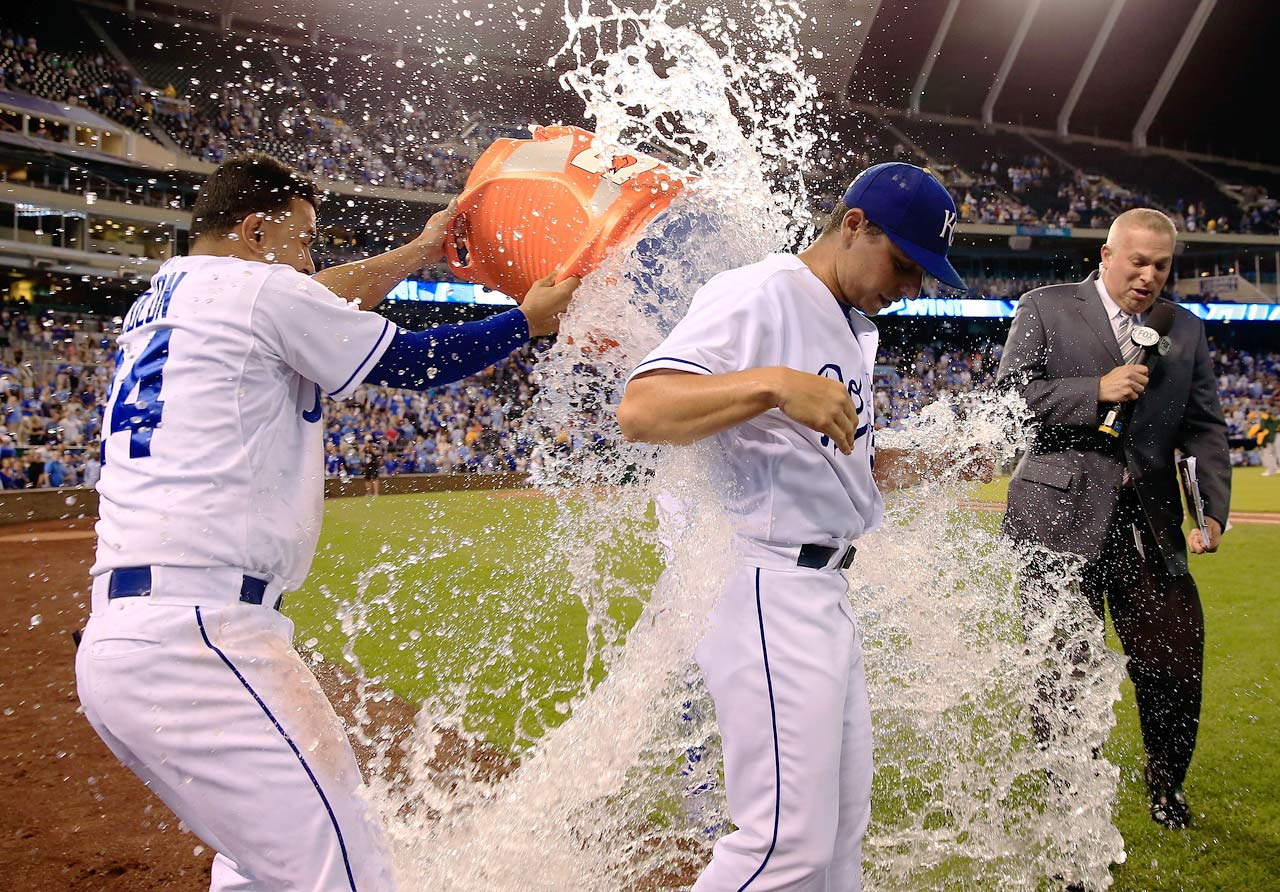 Jason Vargas is doused by teammates Christian Colon and Salvador Perez after pitching a complete game shutout in the Royals 3-0 win over the Athletics.