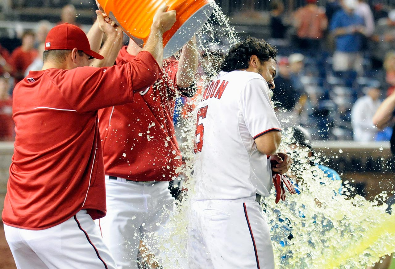 Anthony Rendon is doused by teammates Craig Stammen and Jerry Blevins after his walk-off pinch-hit single in the Nationals 3-2 win over the Diamondbacks.