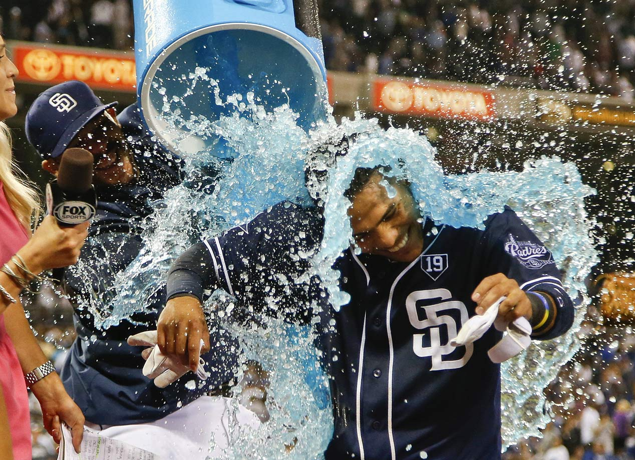 Alexi Amarista is doused by a teammate after his game-winning single in the 10th inning of the Padres 2-1 win over the Dodgers.