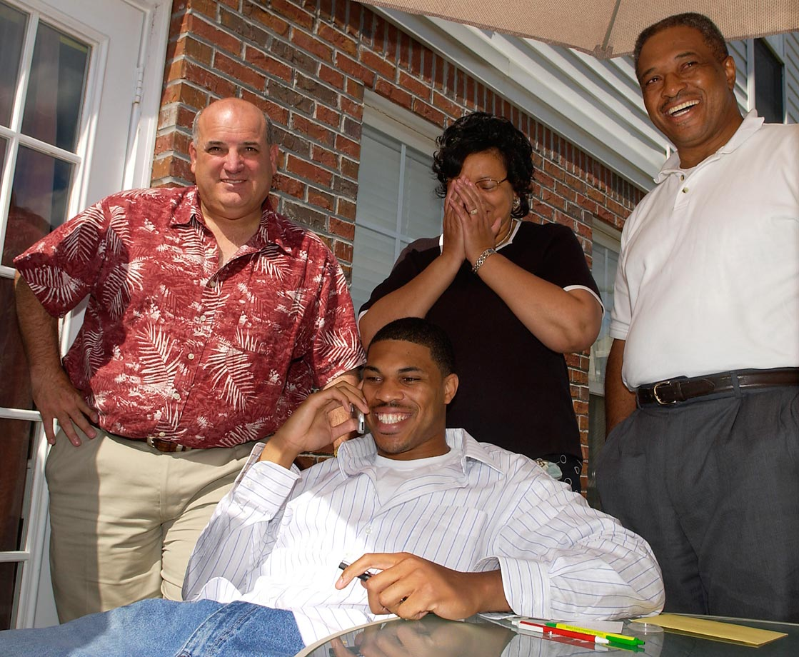 Former Auburn quarterback Jason Campbell talks on the phone with Washington Redskins coach Joe Gibbs after the Redskins selected him with the 25th pick in the 2005 draft.