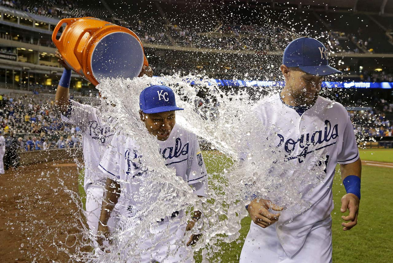Terrance Gore and Alex Gordon are doused by teammate Salvador Perez following the Royals 4-1 win over the Rangers.  Gordon hit a two-run home run and pinch runner Gore scored on a stolen base and a throwing error in the game.
