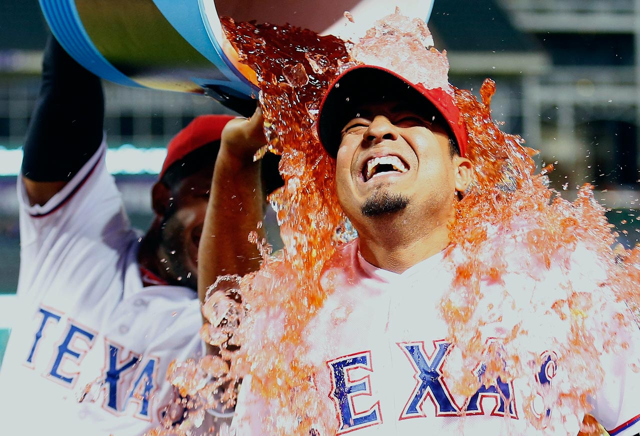 Guilder Rodriguez is doused by teammate Elvis Andrus following the Rangers 4-3 win over the Astros.  Rodriguez had his first two major league hits, including a tiebreaking RBI single, after playing 13 seasons in the minors.