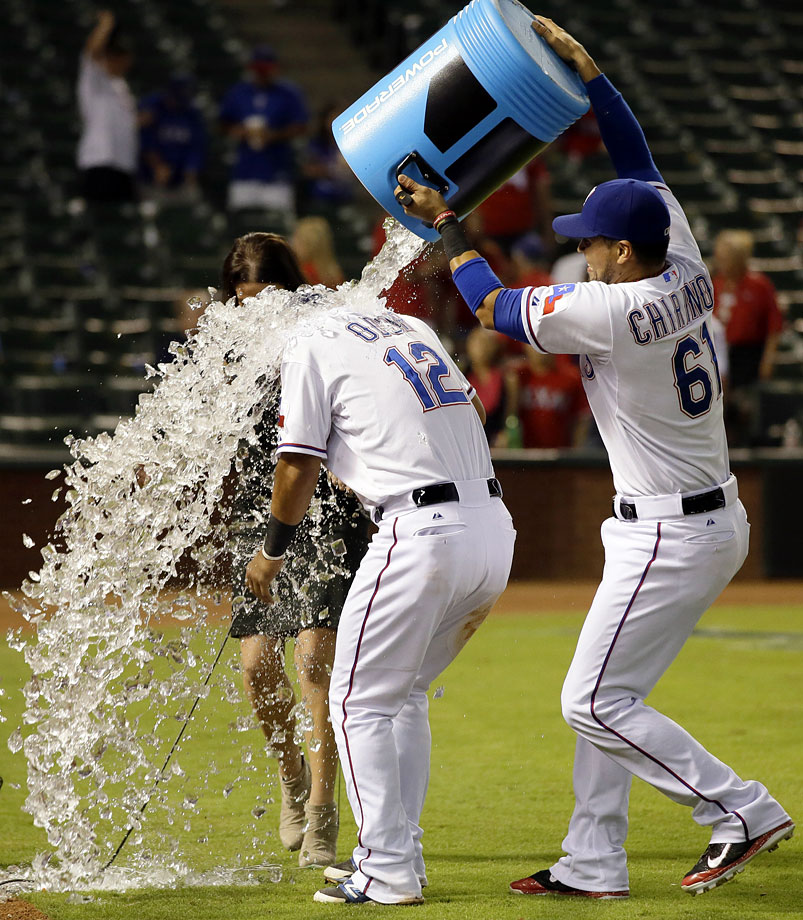 Rougned Odor is doused by teammate Robinson Chirinos following the Rangers 5-1 win over the Astros.  Odor had a home run in the game.