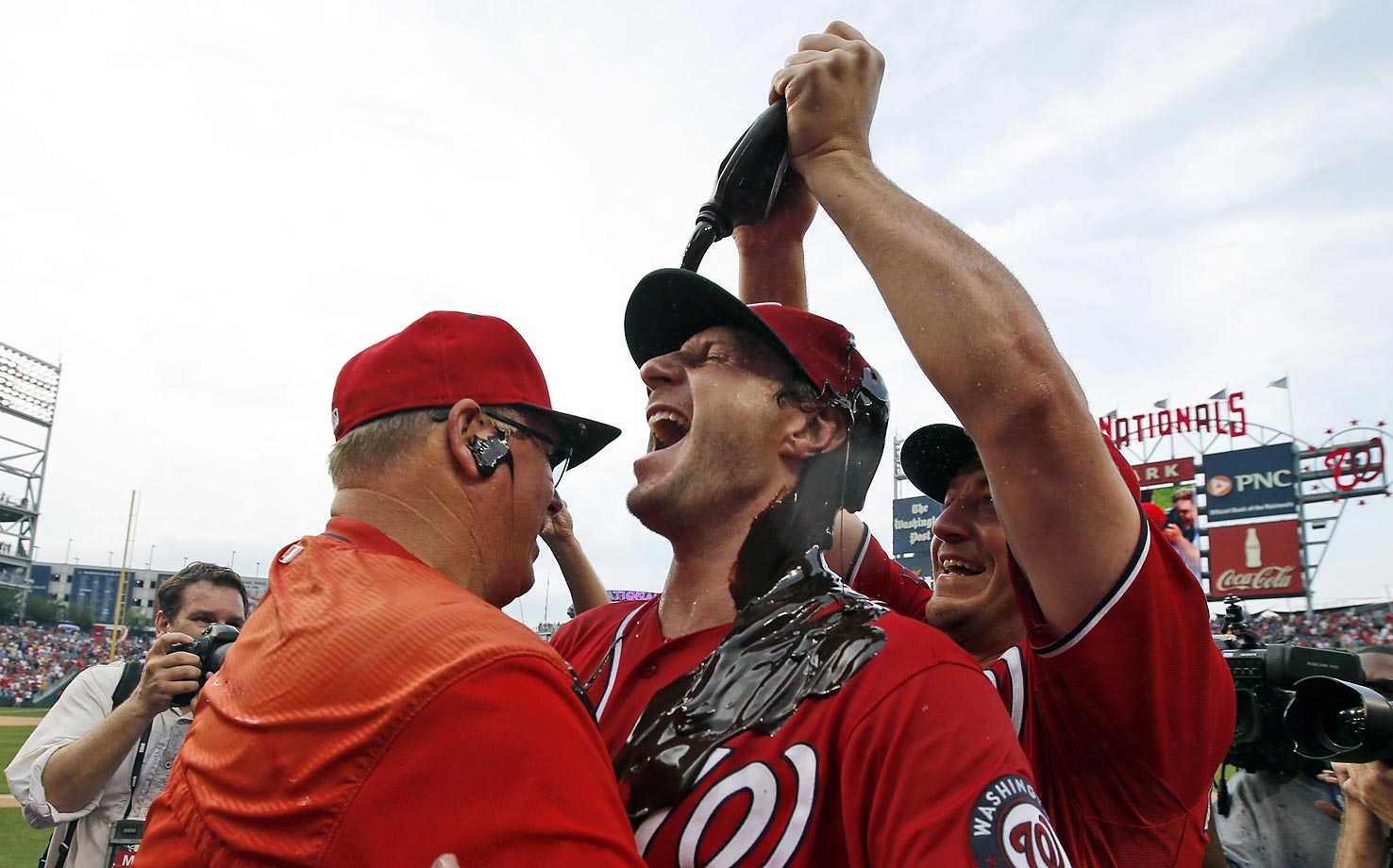 Jordan Zimmermann of the Washington Nationals douses starting pitcher Max Scherzer with chocolate syrup after Scherzer threw a no-hitter.