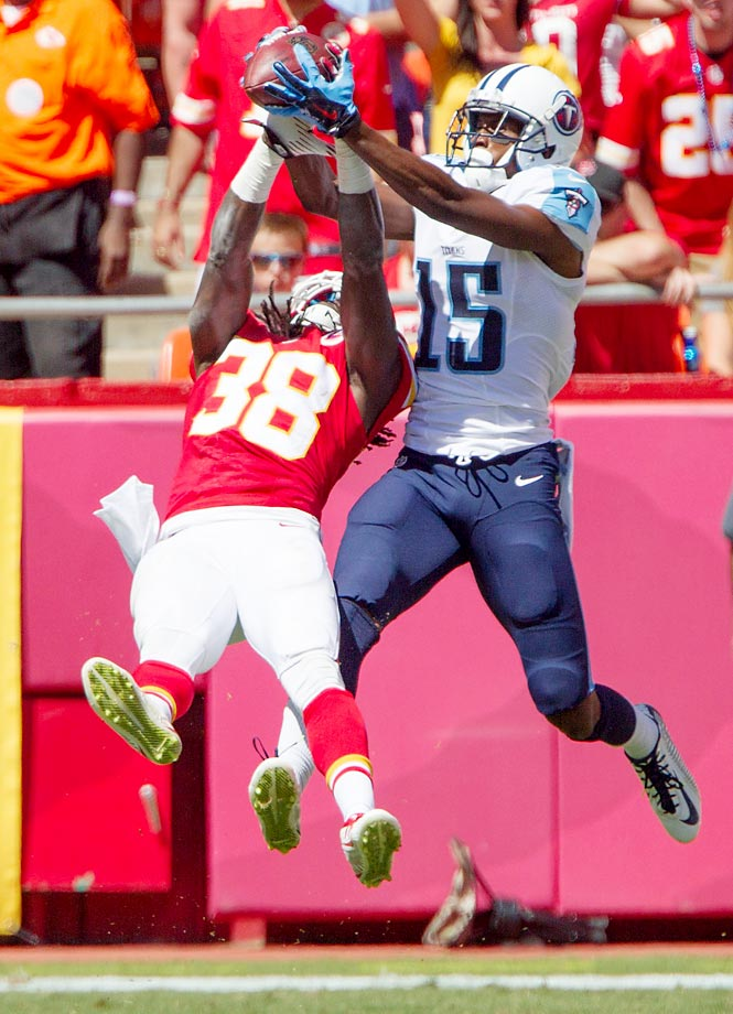 Ron Parker of the Kansas City Chiefs breaks up a pass intended for Justin Hunter of the Tennessee Titans.
