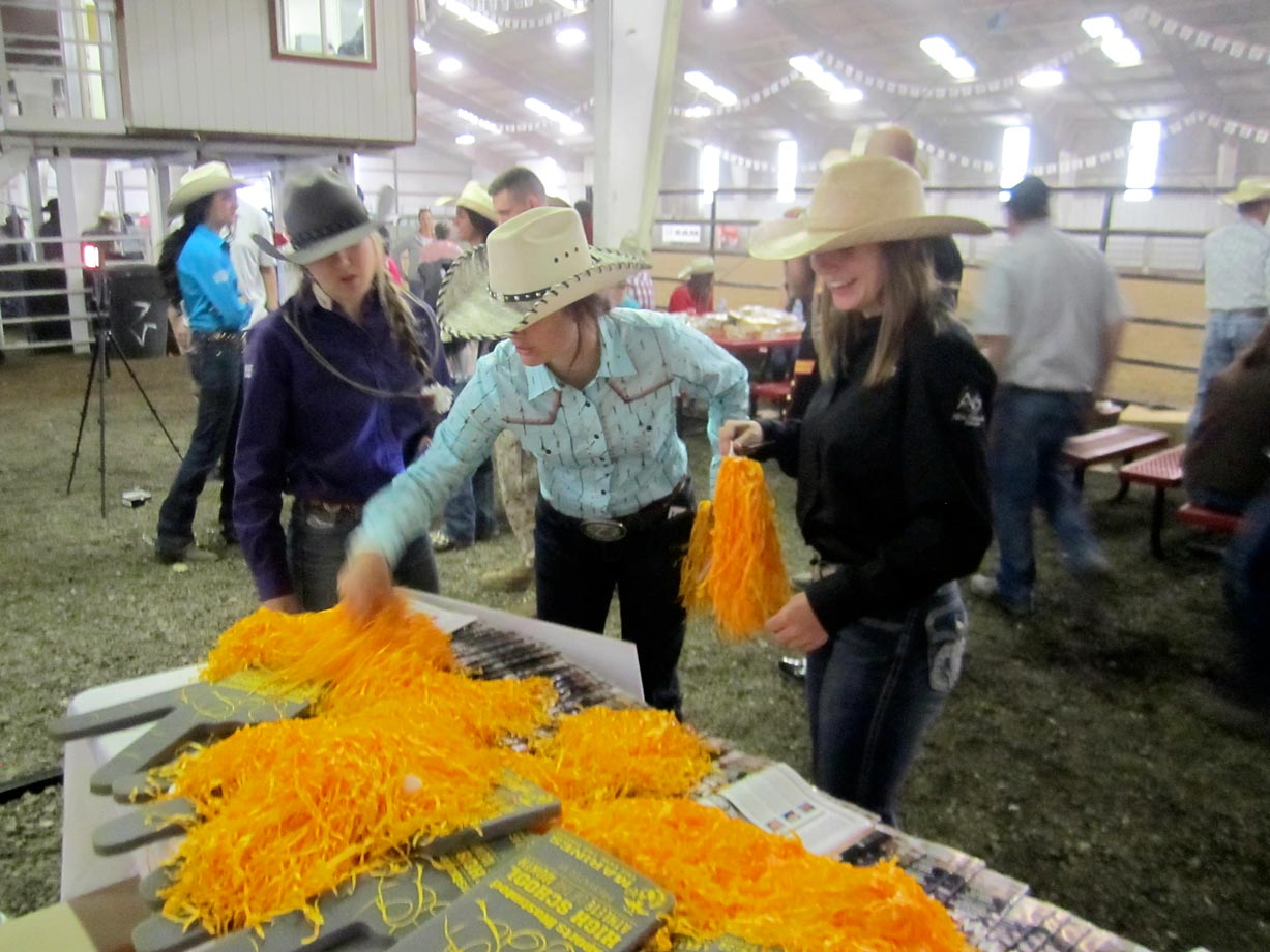 High school rodeo athletes and spectators snapped up free foam fingers, pom-poms and copies of Sports Illustrated at the event.