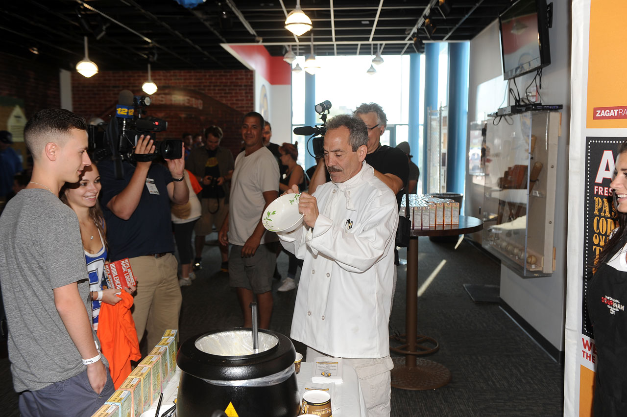 The Soup Nazi, Larry Thomas, autographs a soup bowl.