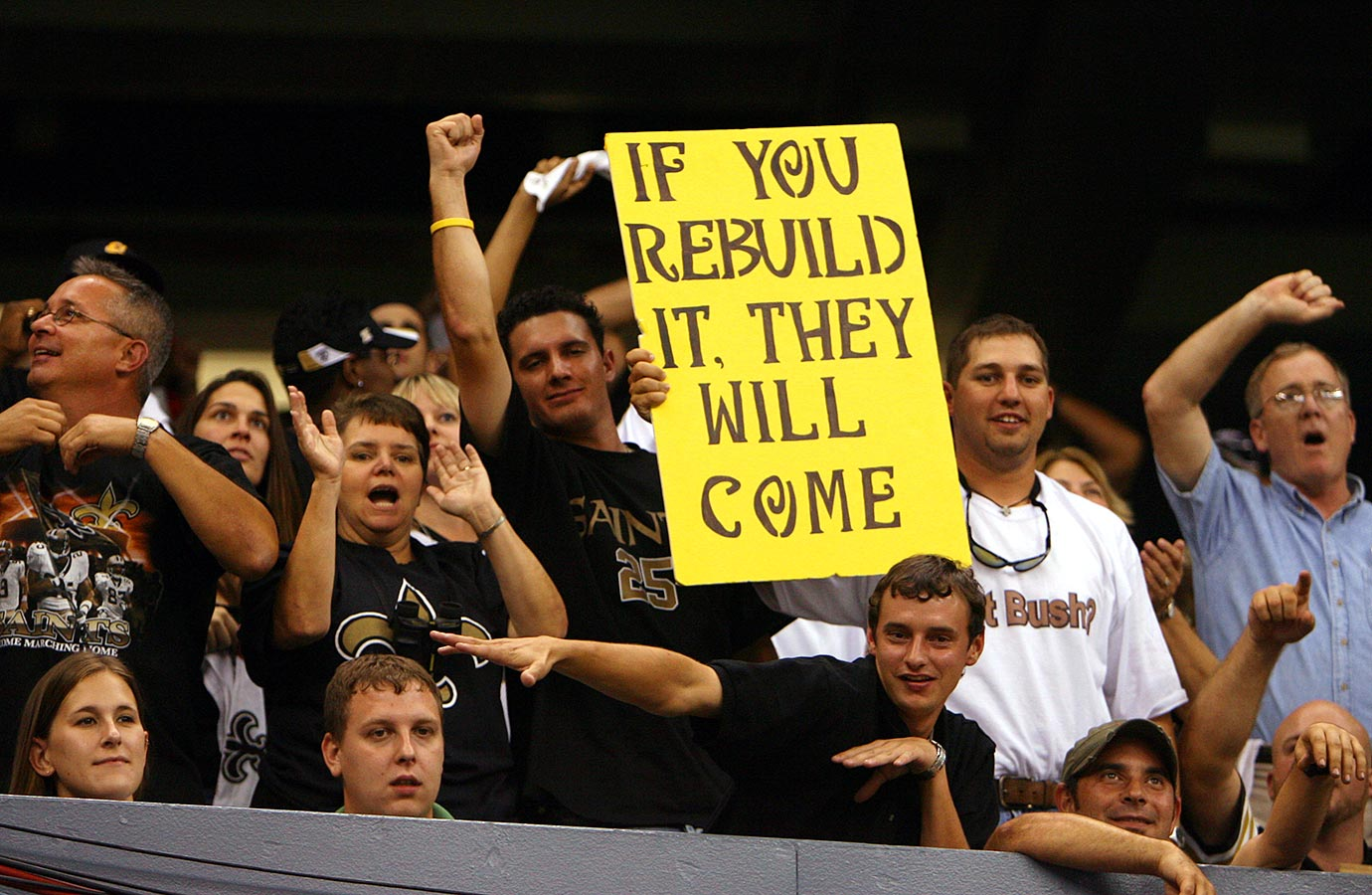 Sept. 25, 2006: Saints fans cheer before the team's first game back at the Superdome.