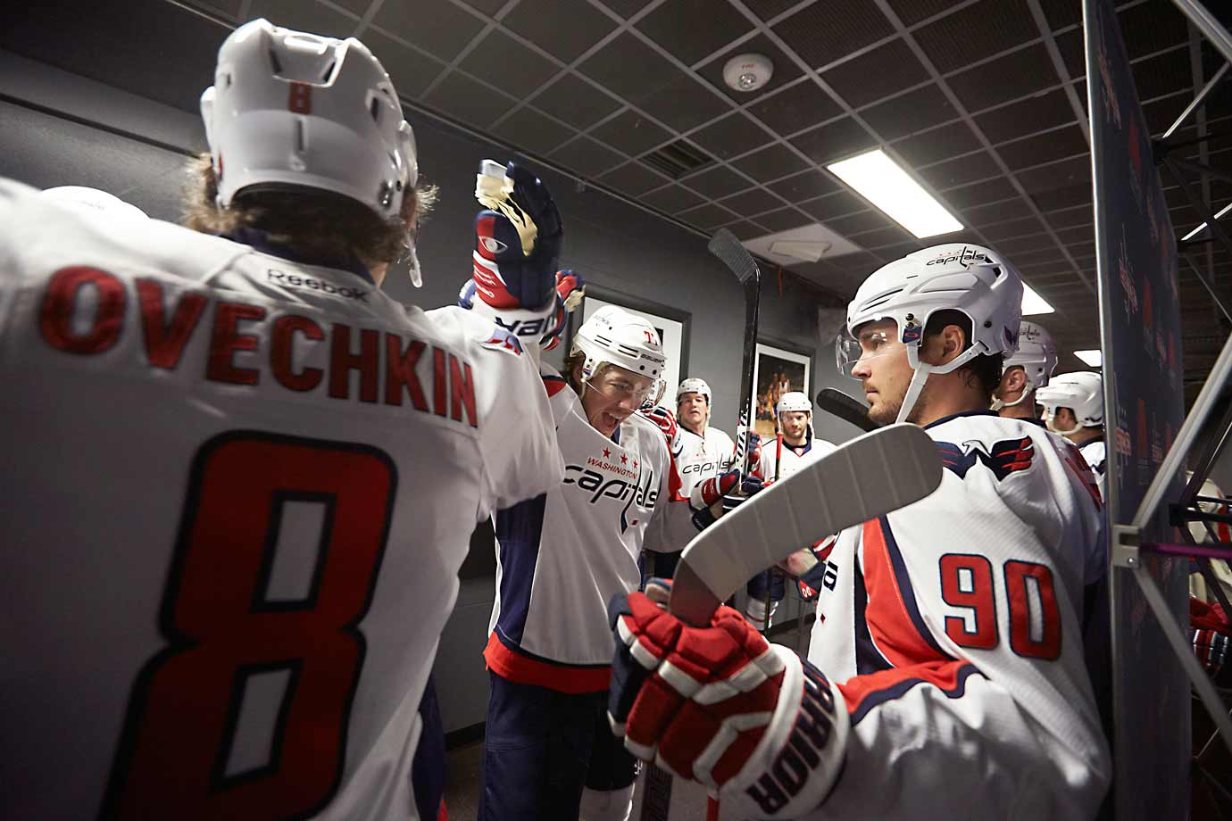 Having done their best to shake off the effects of the previous night's game and prepare for the next tilt, the Capitals share a moment before taking the ice against the Maple Leafs.