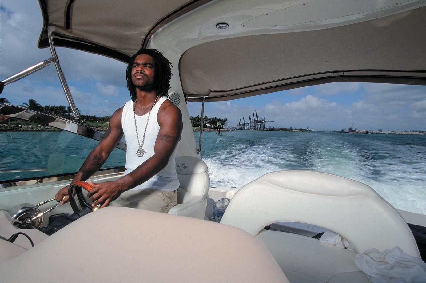 The Indianapolis Colts running back steers his boat near Miami in 2001.