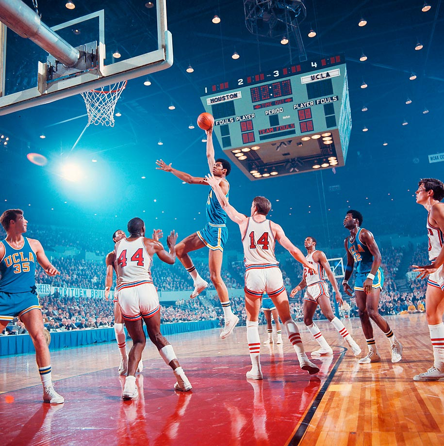 UCLA center Lew Alcindor shoots his trademark sky hook during the Final Four semifinal game in Los Angeles. Also pictured is UCLA forward Mike Lynn (35), guard Lucius Allen (42), Houston forward Elvin Hayes (44), center Ken Spain (14) and guard Don Chaney (24). UCLA defeated the Cougars 101-69 to meet North Carolina in the championship game.