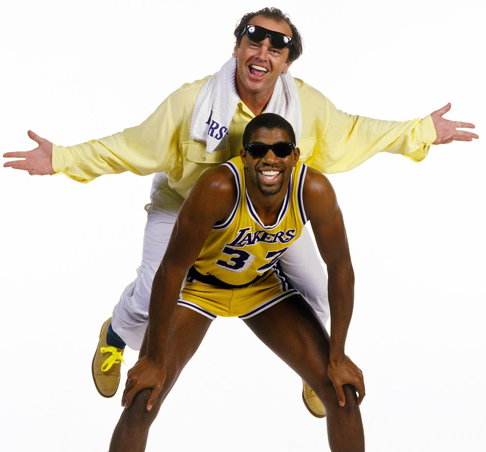"""Jack Nicholson has for years been sitting courtside at Lakers games, but sometimes he feels the need to get even closer to the action. In this photo, the actor hops on the back of Magic Johnson, who at the time was the heartbeat of the """"Showtime"""" Lakers."""