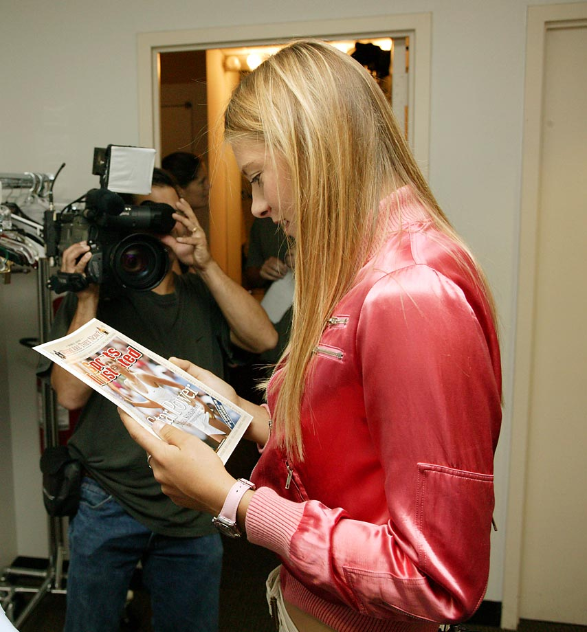 Sharapova looks at her Sports Illustrated cover while backstage.