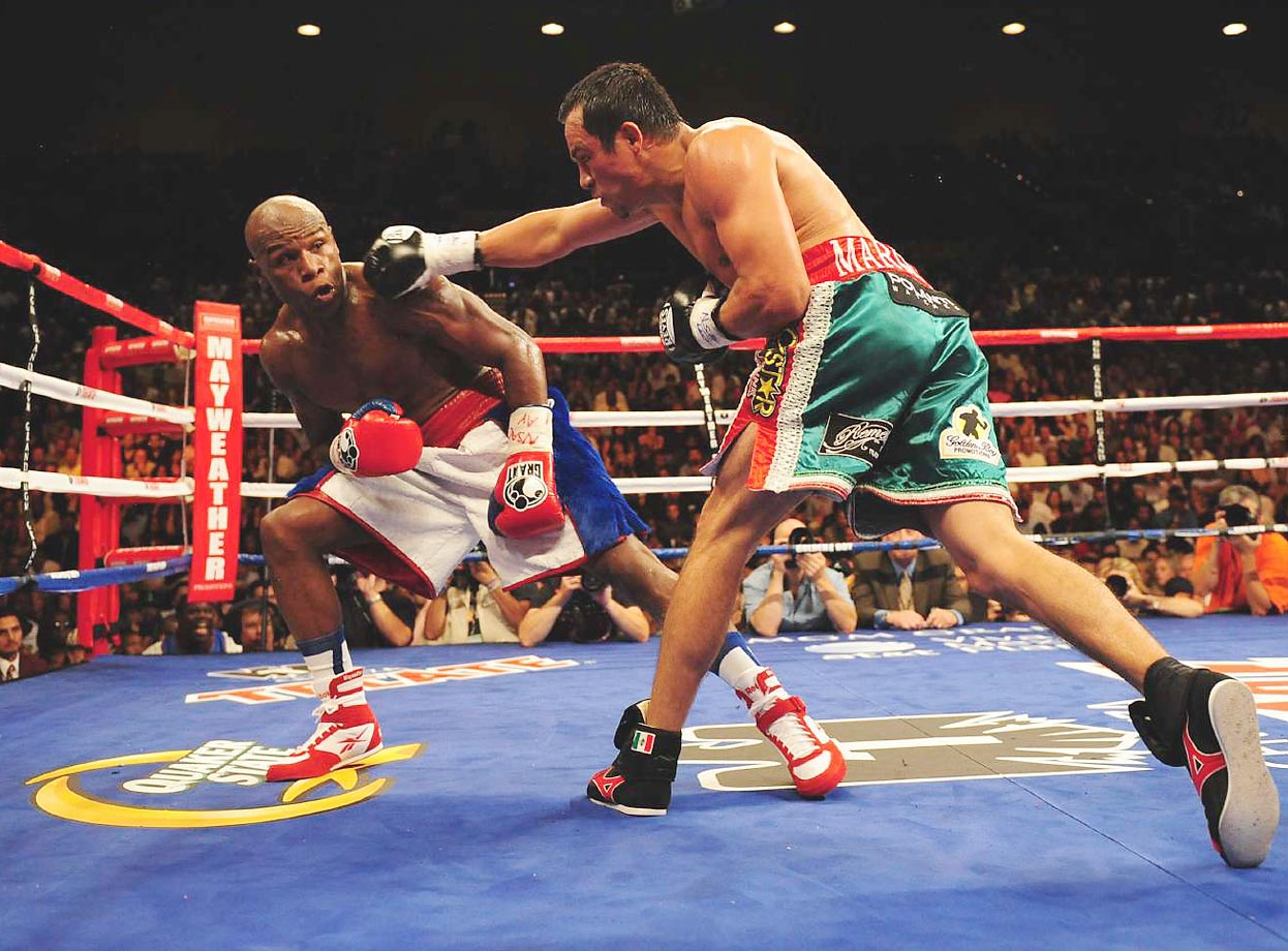 "Mayweather showed little ring rust in a ""comeback"" fight against Marquez, the lightweight champion and the No. 2-ranked pound-for-pound fighter according to most experts. The fight proved one-sided from start to finish, as Mayweather's preternatural defensive skills confounded Marquez, who connected on just 12 percent of his punches in a unanimous-decision loss."