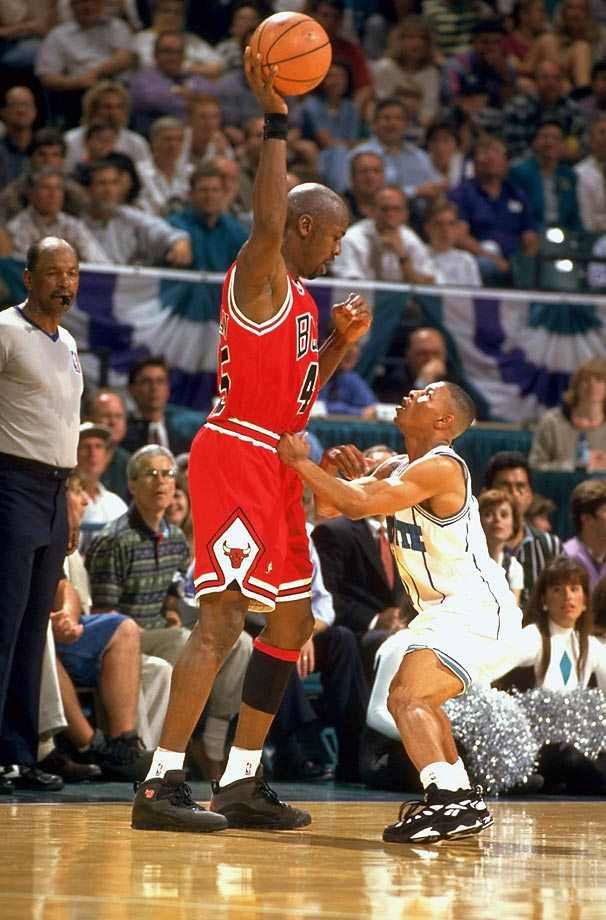 Back from his first retirement, Michael Jordan attempts to keep the ball out of Muggsy Bogues' reach in Game 1 of a playoff series. Bogues would take on Jordan the following year as well, only as a cartoon monster in the sports comedy film Space Jam.