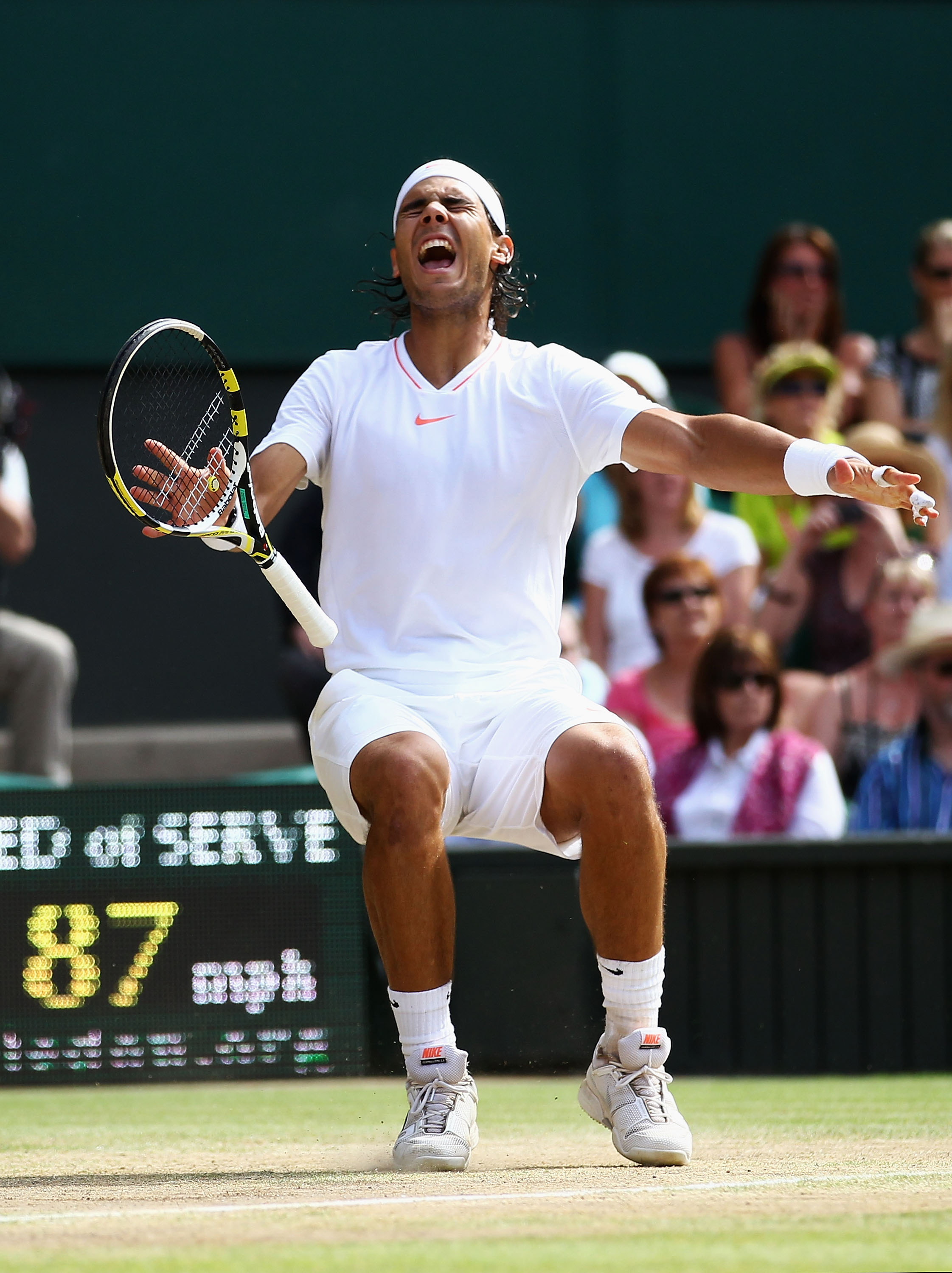 Nadal wins his second Wimbledon title in a v-neck.