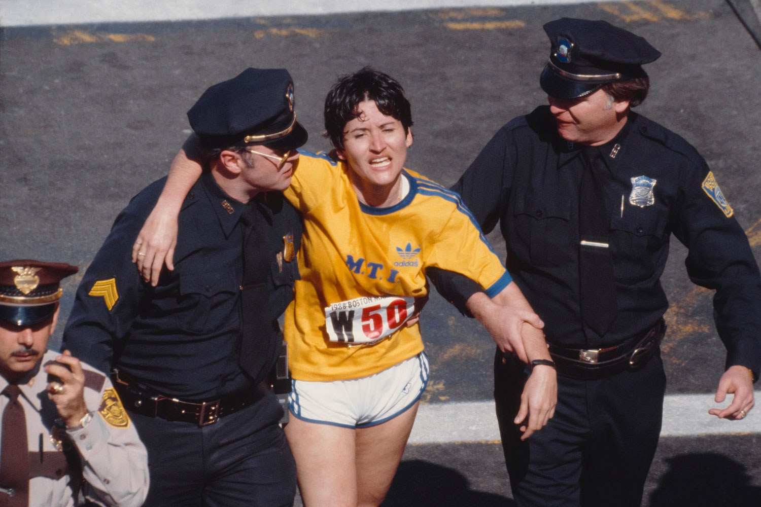Rosie Ruiz is shown moments after crossing the finish line of the 84th Boston Marathon in April 1980. Ruiz was later stripped of the victory after it was revealed she hadn't completed the entire race.