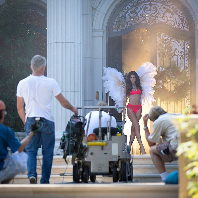 What's a #VSHoliday shoot without wings? (And @lilyaldridge, of course.)#BTS