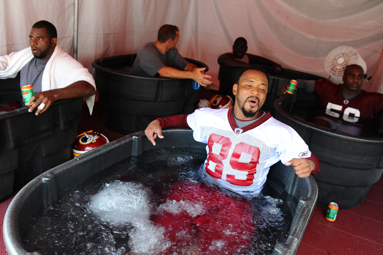 Former Redskins wide receiver Santana Moss lets out a sigh as he dips in the freezing ice bath following their first workout of training camp in July 2010.