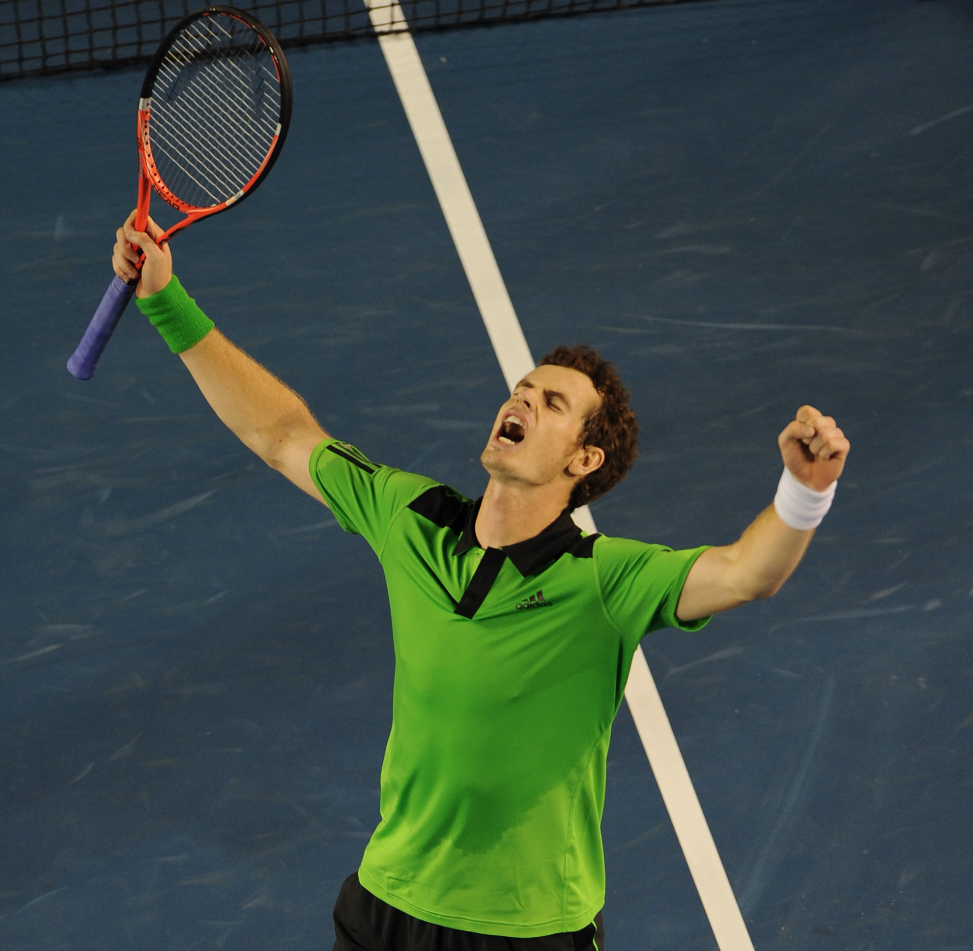 In yet another polo shirt, Murray makes his third Slam final, this time losing to Djokovic.