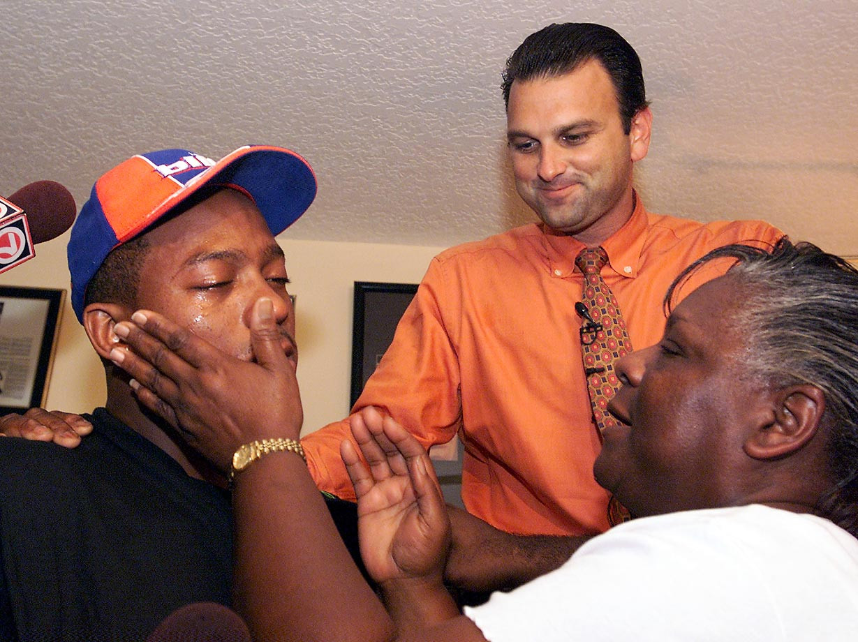 University of Miami running back Willis McGahee has his mother wipe tears after he was picked 23rd by the Buffalo Bills in the 2003 draft. McGahee was the first running back picked that year.