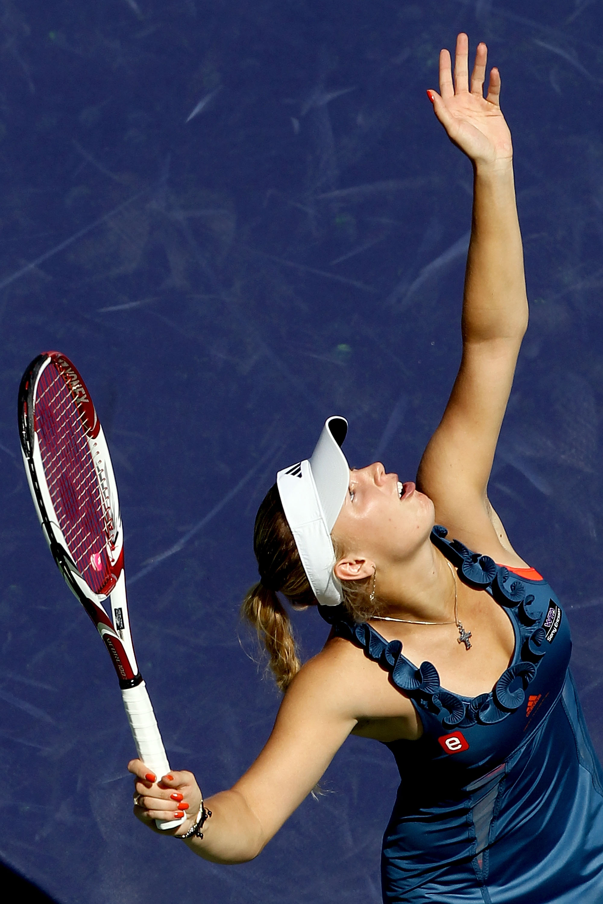 Quite possibly the worse neckline in the history of tennis fashion. Oy.
