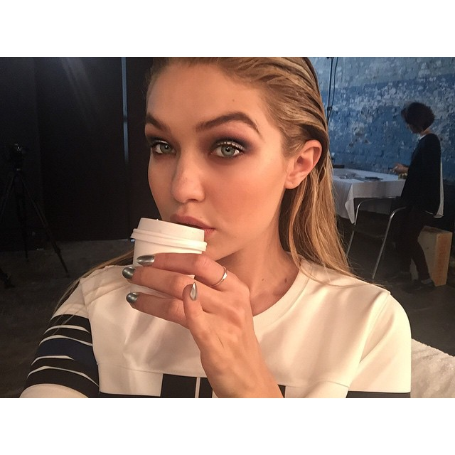 yesterday on set: eyebrows on fleeeeek bc @makeupvincent kills the game. also pinky up for da cutest mini coffee cup