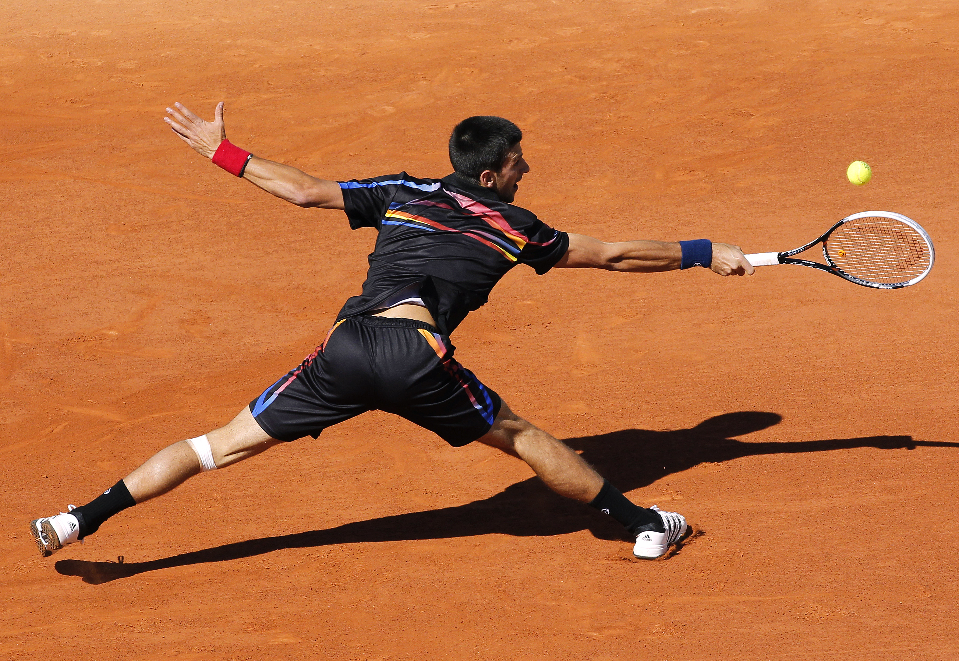 The rainbow pattern on the front and back of Novak's polo and shorts was too much for Roland Garros.