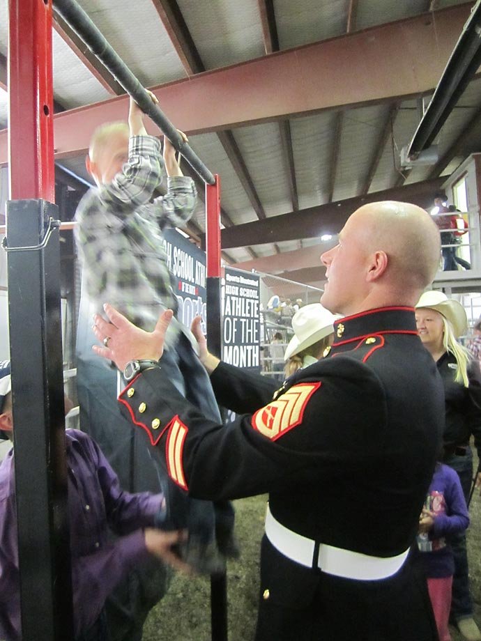 The U.S. Marine Corps held a pull-up bar challenge that attracted people of all ages.