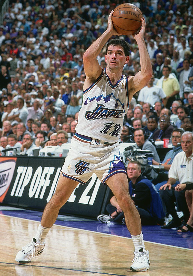"A 10-time All-Star and half of perhaps the most prolific guard-post tandem ever, John Stockton remains the NBA's all-time leader in assists and steals. He dominated games at a slender 6'1"", with incredible know-how, a hard-nosed approach on both ends and unbelievable consistency all the way until his retirement at age 40. For the definition of a pure point guard, look no further."