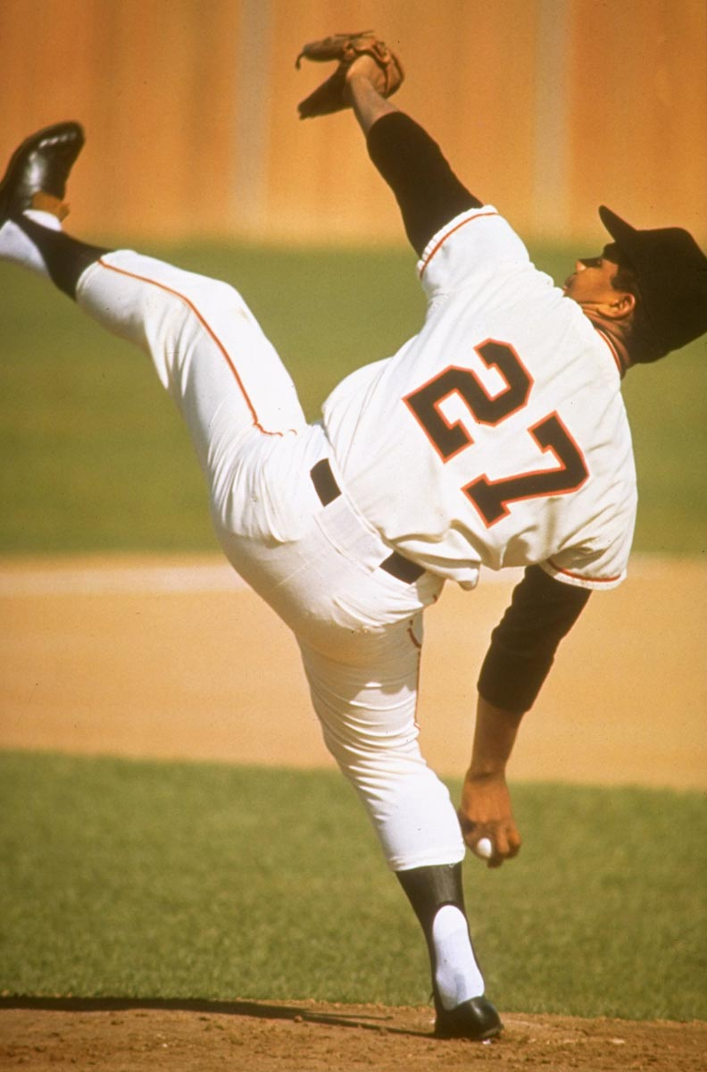 Spring Training, March 8, 1965 | San Francisco Giants pitcher Juan Marichal winds up for a pitch during a spring training game in Casa Grande, Ariz. Marichal was known for his distinctive windup, which consisted of one of the highest leg kicks in major league history.