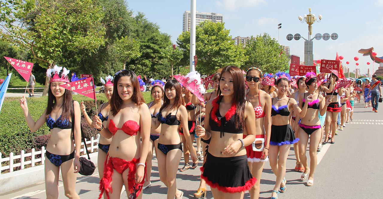 A total of 1,085 women took part in the World's Largest Bikini Parade, setting a new Guinness World Record during the 2nd China International Beach & Bikini Culture Exposition on Aug. 19, 2012 in Huludao, Liaoning, China.