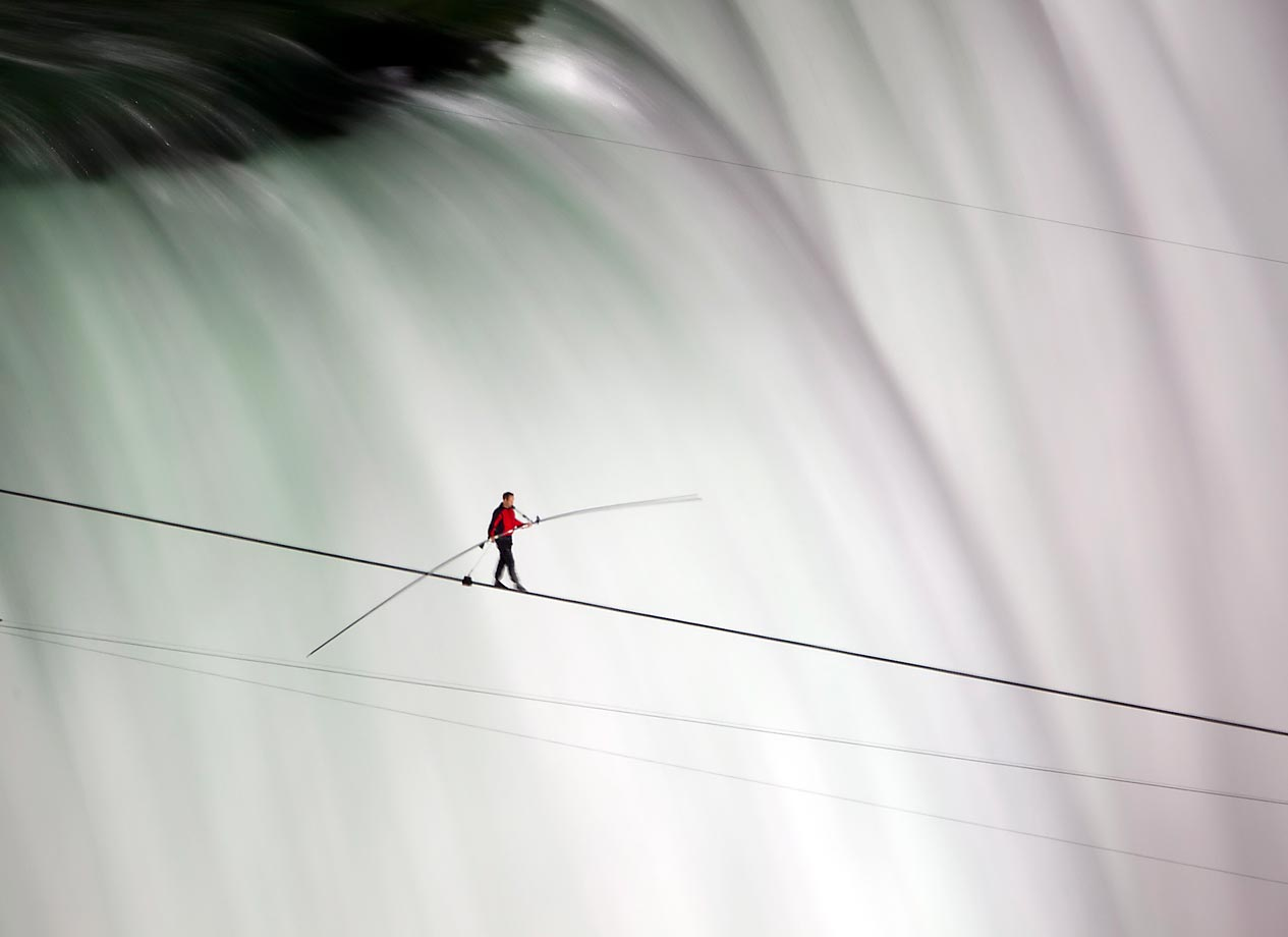 Nik Wallenda walks a 1,800-foot tightrope, suspended 173 feet in the air, from the U.S. side to the Canadian side directly over the Horseshoe Falls in Niagara Falls, Ontario. The famous funambulist is the first to achieve this feat. He holds six world records for other tightrope walking stunts, including the longest and highest tightrope crossing by bicycle.