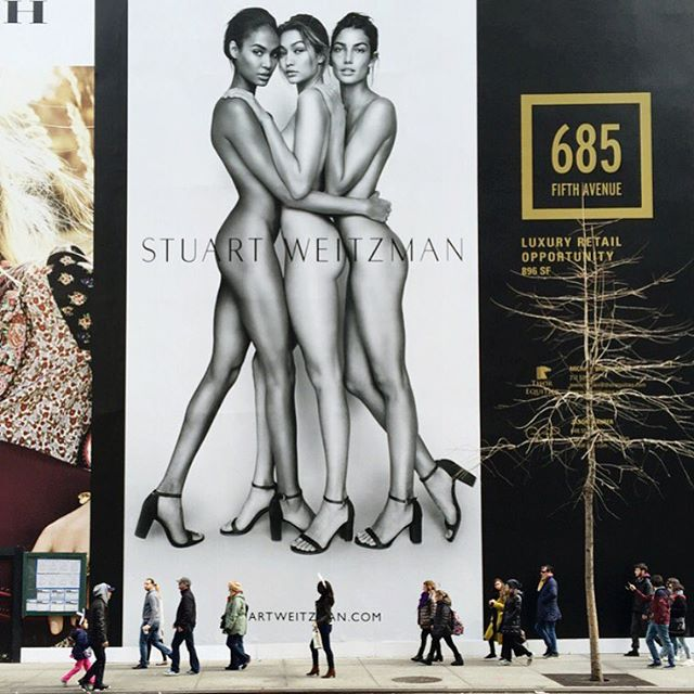 Major is an Understatement. @joansmalls @gigihadid + @lilyaldridge watch over 5th Avenue w/ their giant @stuartweitzman billboard. @mariotestino #IMGstars