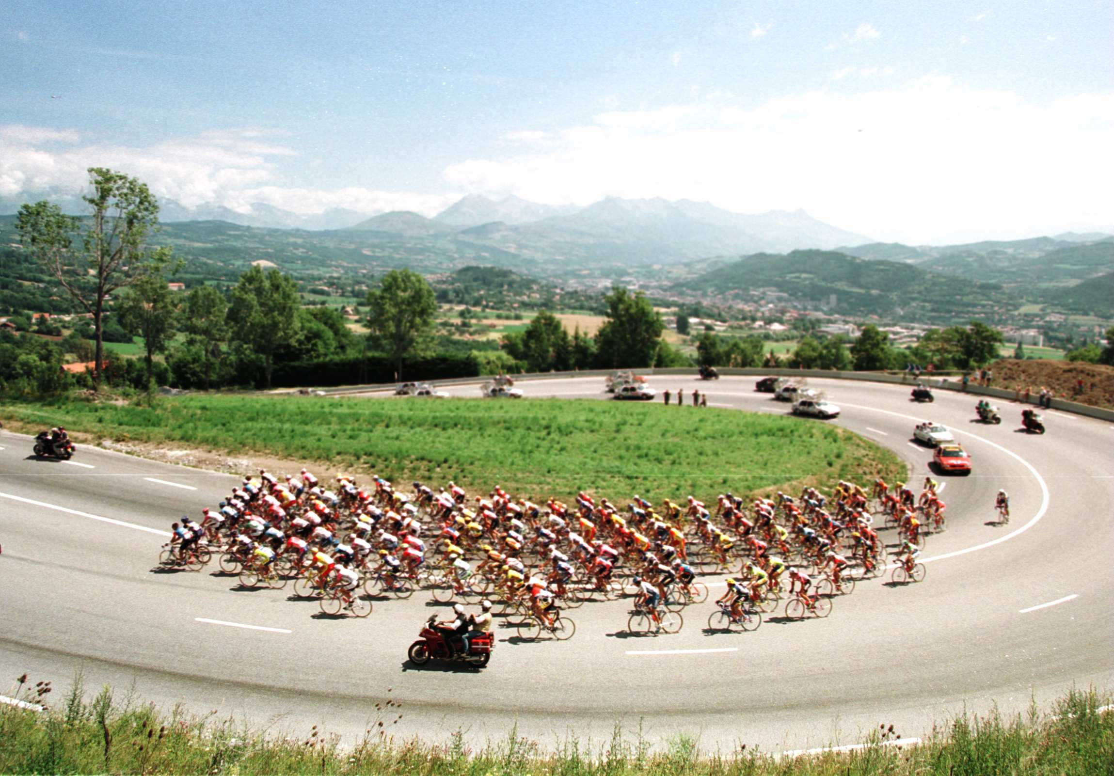 The peleton climbing La Freissinouse leaving the start at Gap on its way on the 11th stage of the Tour De France in 1996.