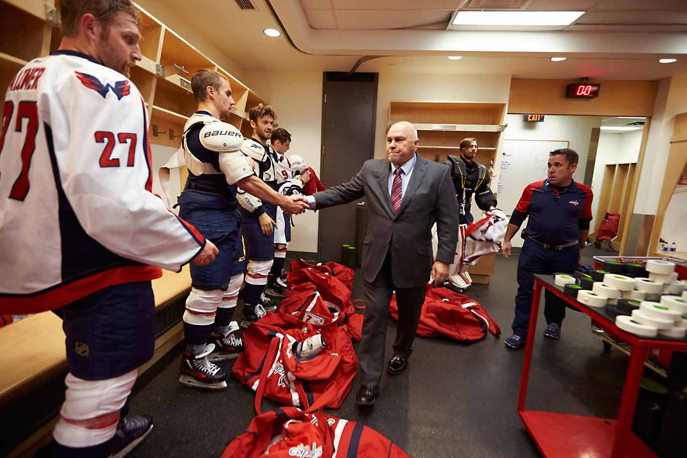 Coach Barry Trotz congratulates his troops after their victory.