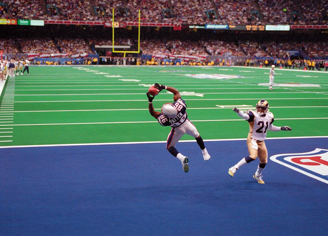 New England Patriots wide receiver David Patten makes an acrobatic catch for a touchdown against the St. Louis Rams in the second quarter. The catch gave the Patriots a 14-3 lead at halftime; they won 20-17.