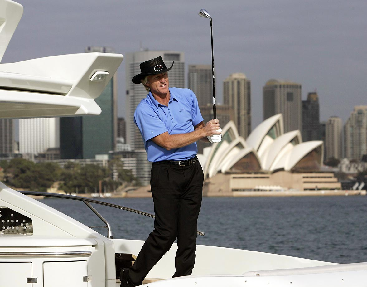 You can put the Shark on the water, but you can't take his irons away. The Australian golfer takes some practice swings on the back of his yacht on Sydney Harbour in May 2006 as he was promoting that season's Australian Open.
