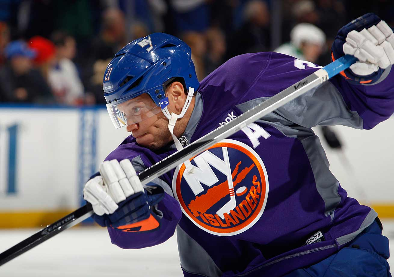 The upstart Islanders' rugged forward uncorks a slap shot during warmups before a game against the Dallas Stars at New York's Nassau Veterans Memorial Coliseum on Oct. 25, 2014.