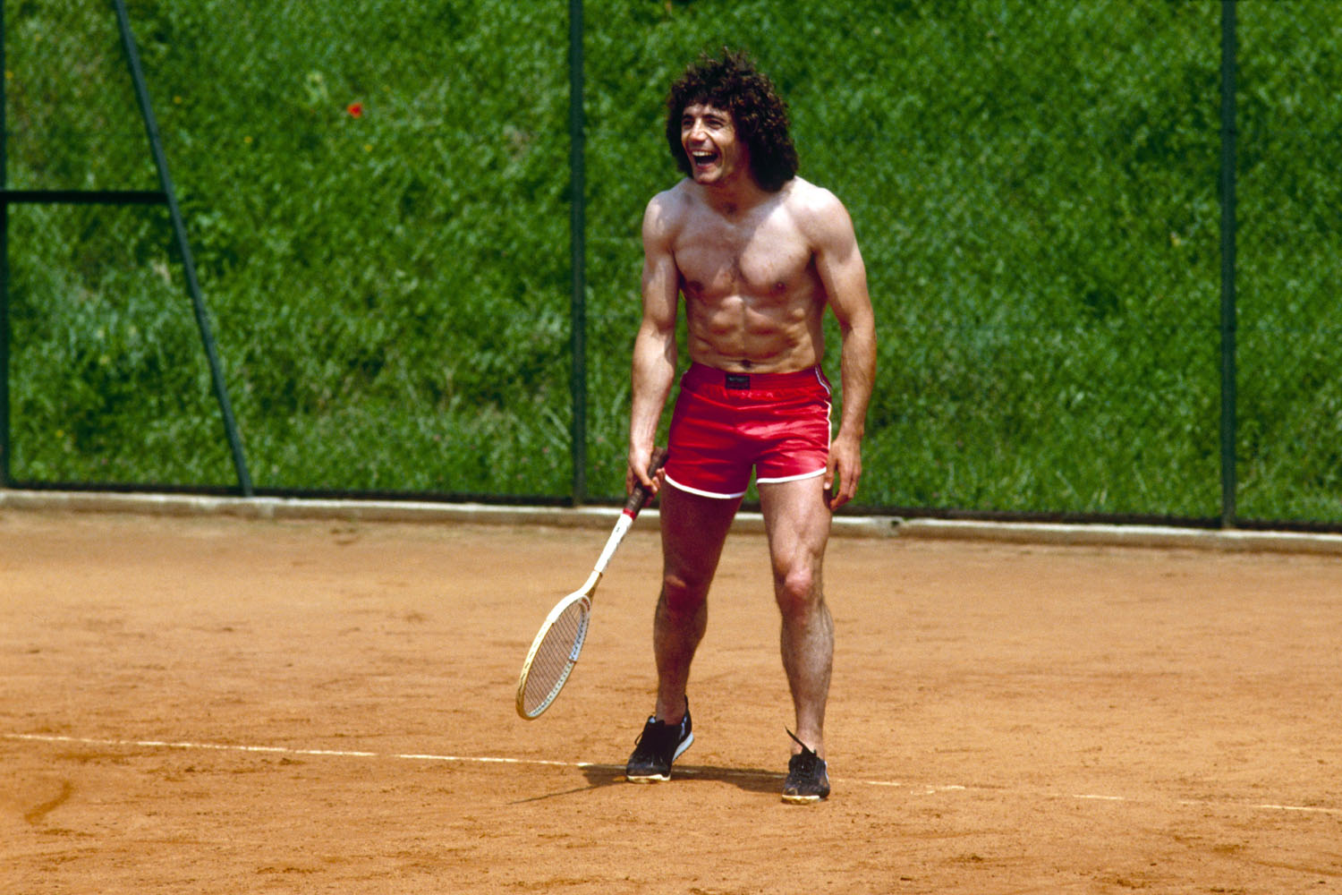 Kevin Keegan plays tennis as he trains with the England World Cup squad on June 10, 1982 at the Los Tamarises Hotel in Playa de Ereaga, Spain.