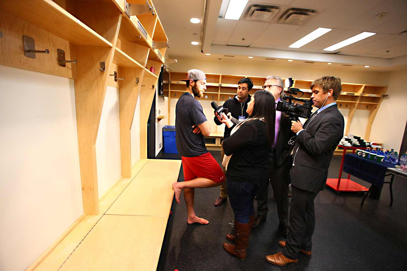Goalie Braden Holtby conducts one of the final interviews with the media. By 9:58 p.m., the visitors' locker room will be a ghost town as the Capitals head to the airport for their flight back to Washington.