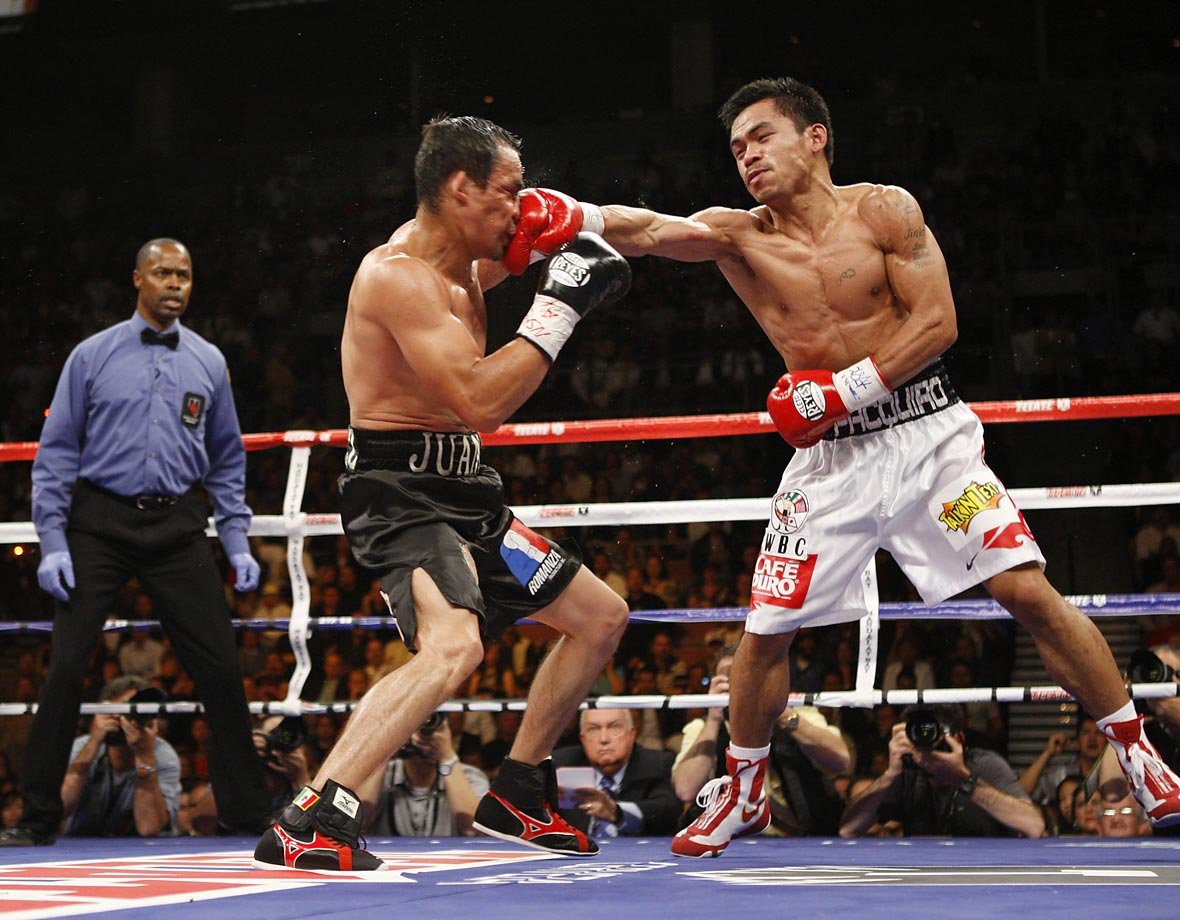 Fighting for the WBC super featherweight title (130 pounds), Pacquiao outpointed Marquez in a narrow decision — a crucial third-round knockdown making the difference. The victory gave Pacquiao the world title in a fourth weight class.