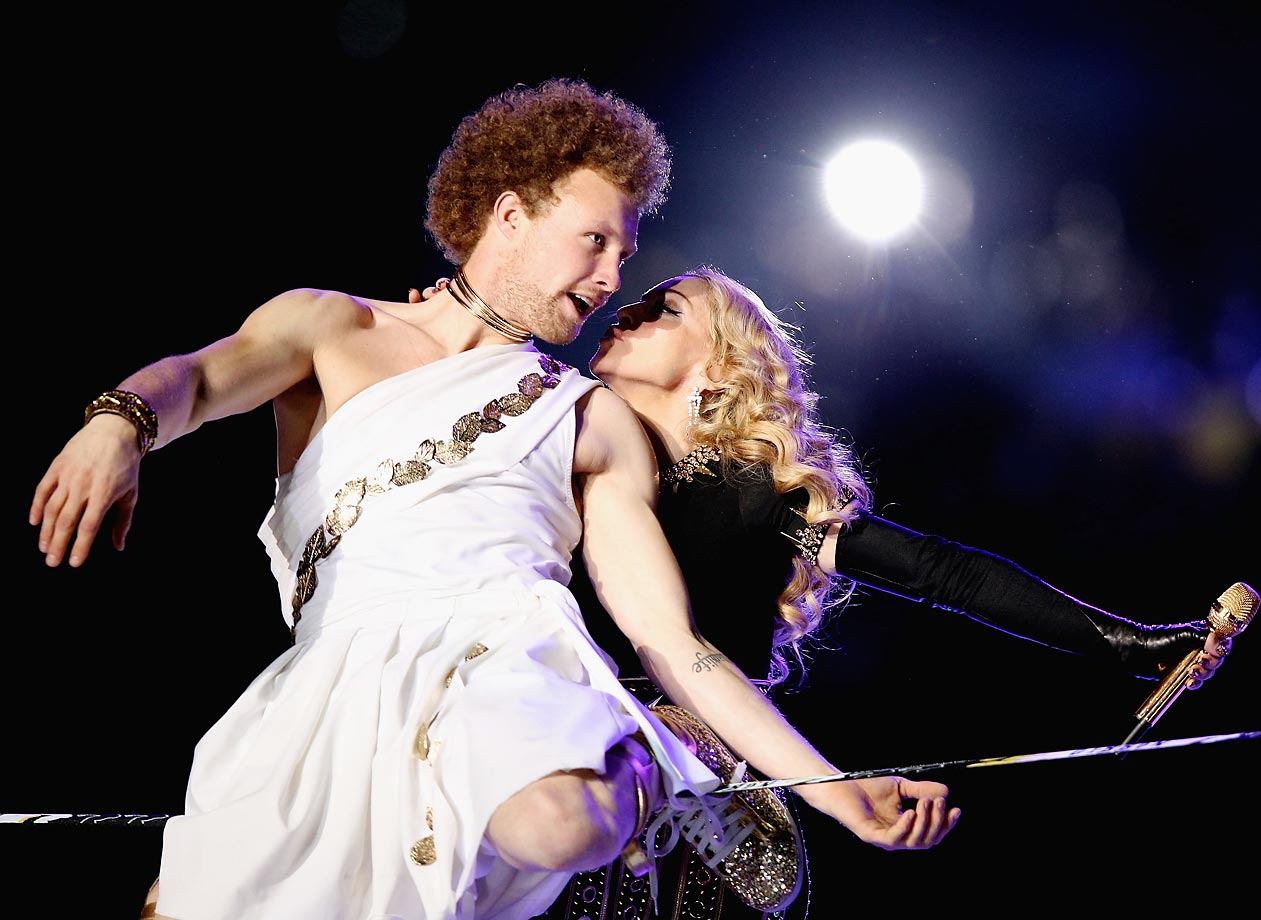 Andy Lewis performs on a slackline as part of Madonna's Super Bowl XLVI halftime show.